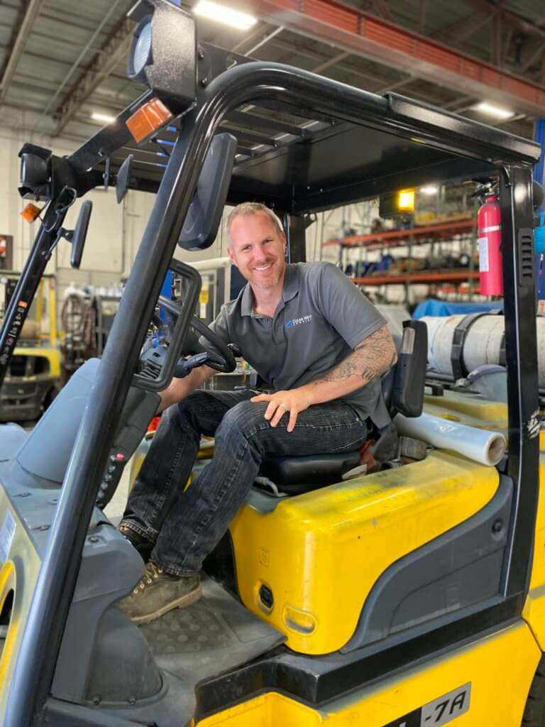 Clear Water employee operating a forklift in the Clear Water Warehouse