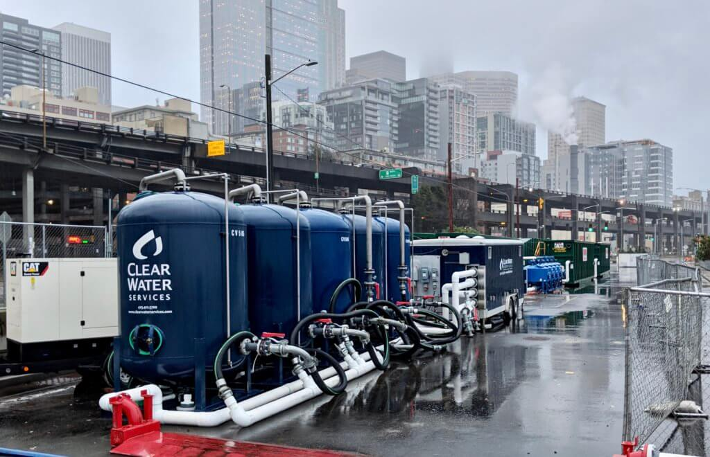 Water treatment system under the Alaskan Way Viaduct with the Seattle skyline in the background